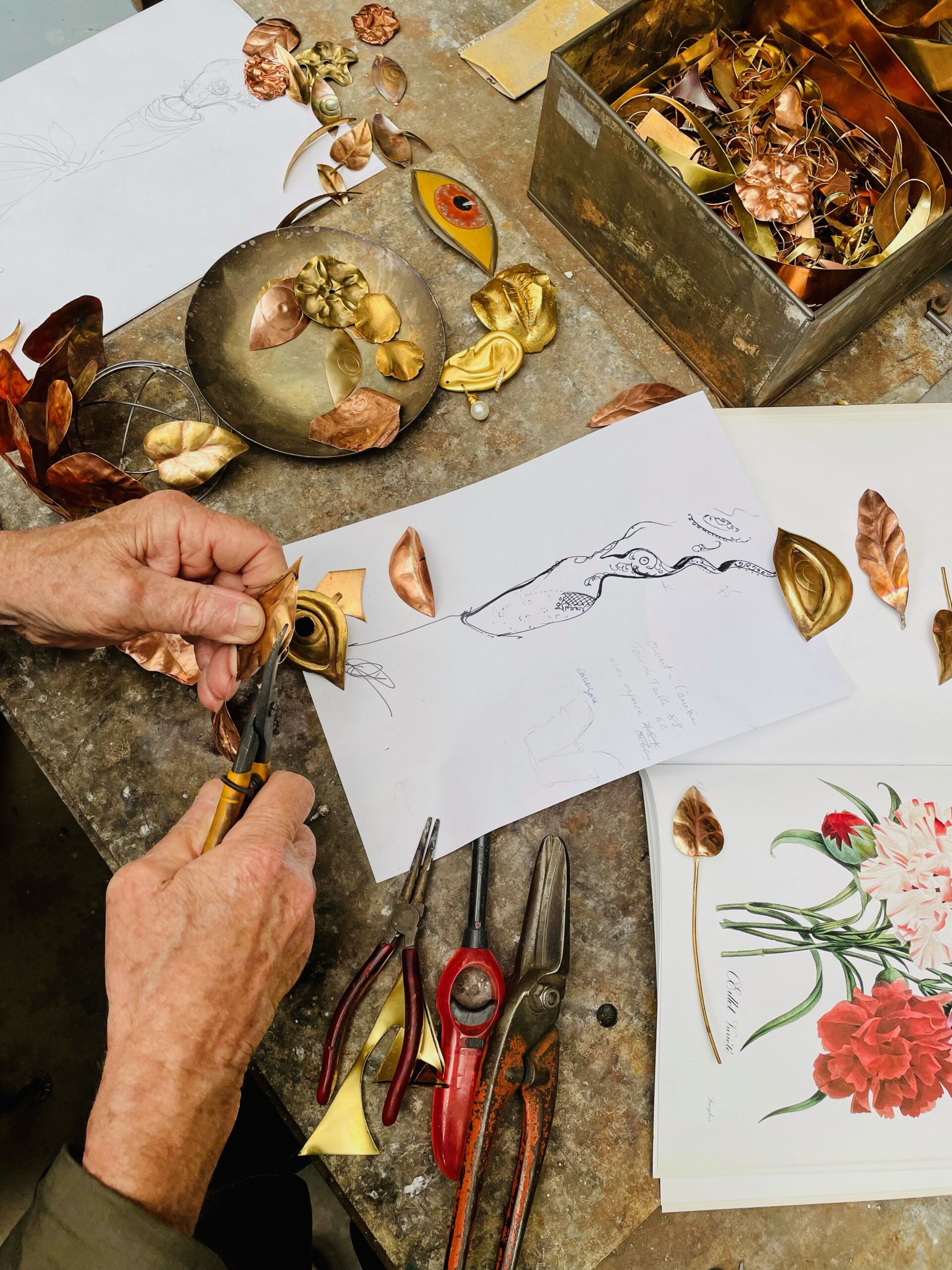 Hands of Michel Carel, who crafts jewelry for Schiaparelli